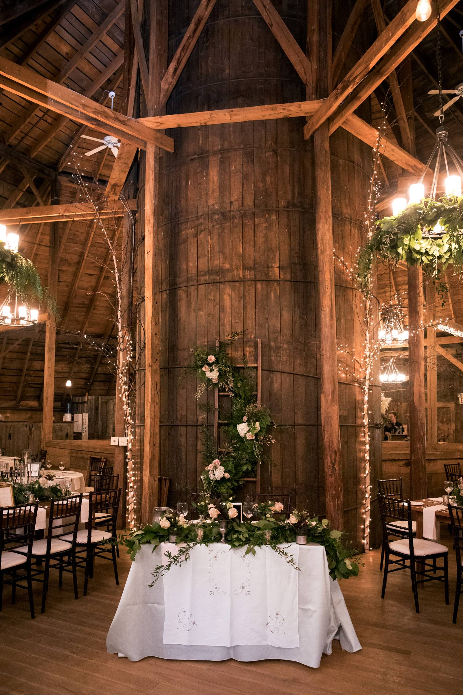 Sweetheart table decor set for romantic fall wedding at the Inn at the Round Barn Farm