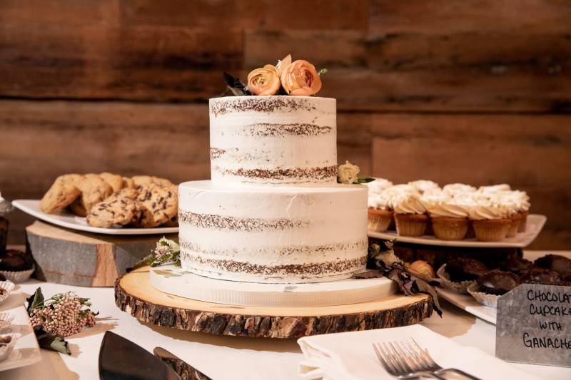 Naked wedding cake with blush flowers for fall wedding at the Inn at the Round Barn Farm