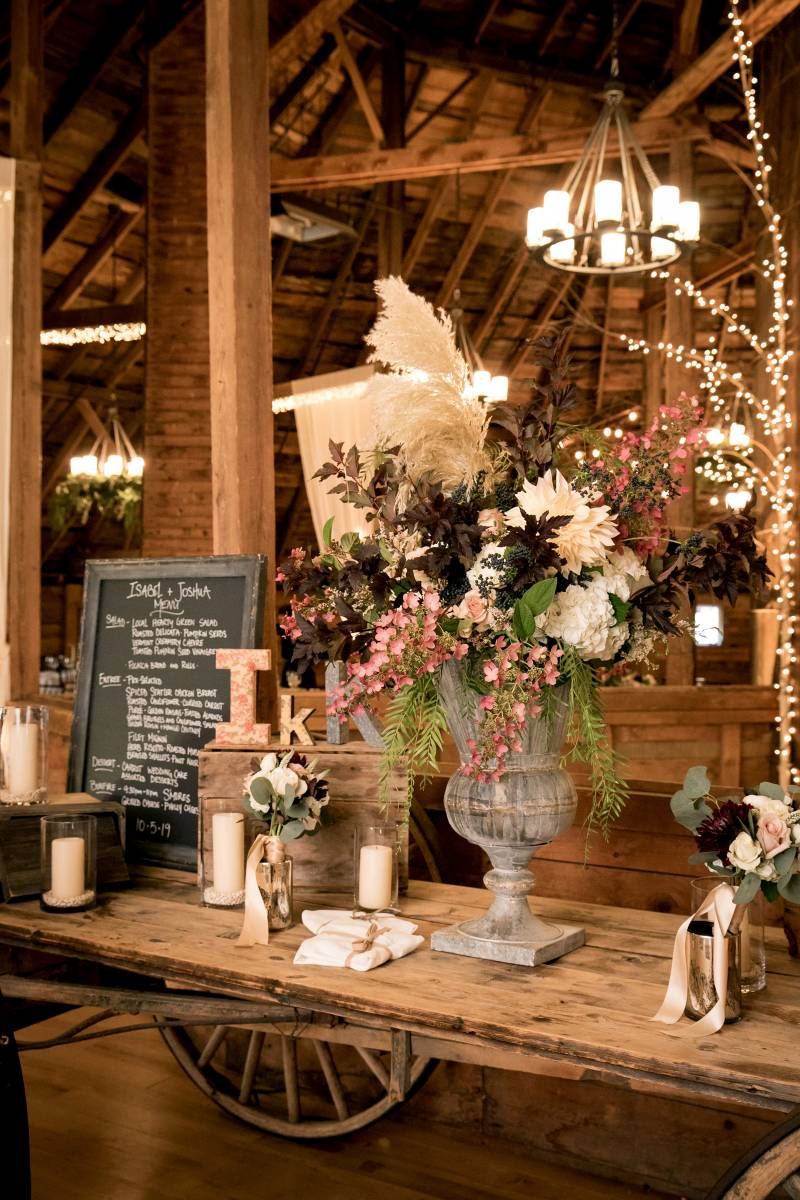 Welcome table set for a romantic fall wedding at the Inn at the Round Barn Farm
