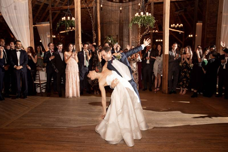 Groom dipping bride during first dance