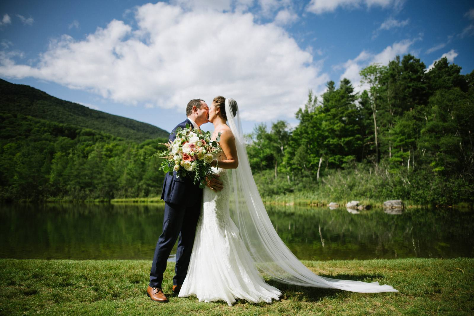Bride and groom first look and kiss at the Equinox on summer wedding day