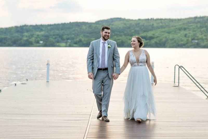 Bride and groom on dock at Basin Harbor Club on wedding day