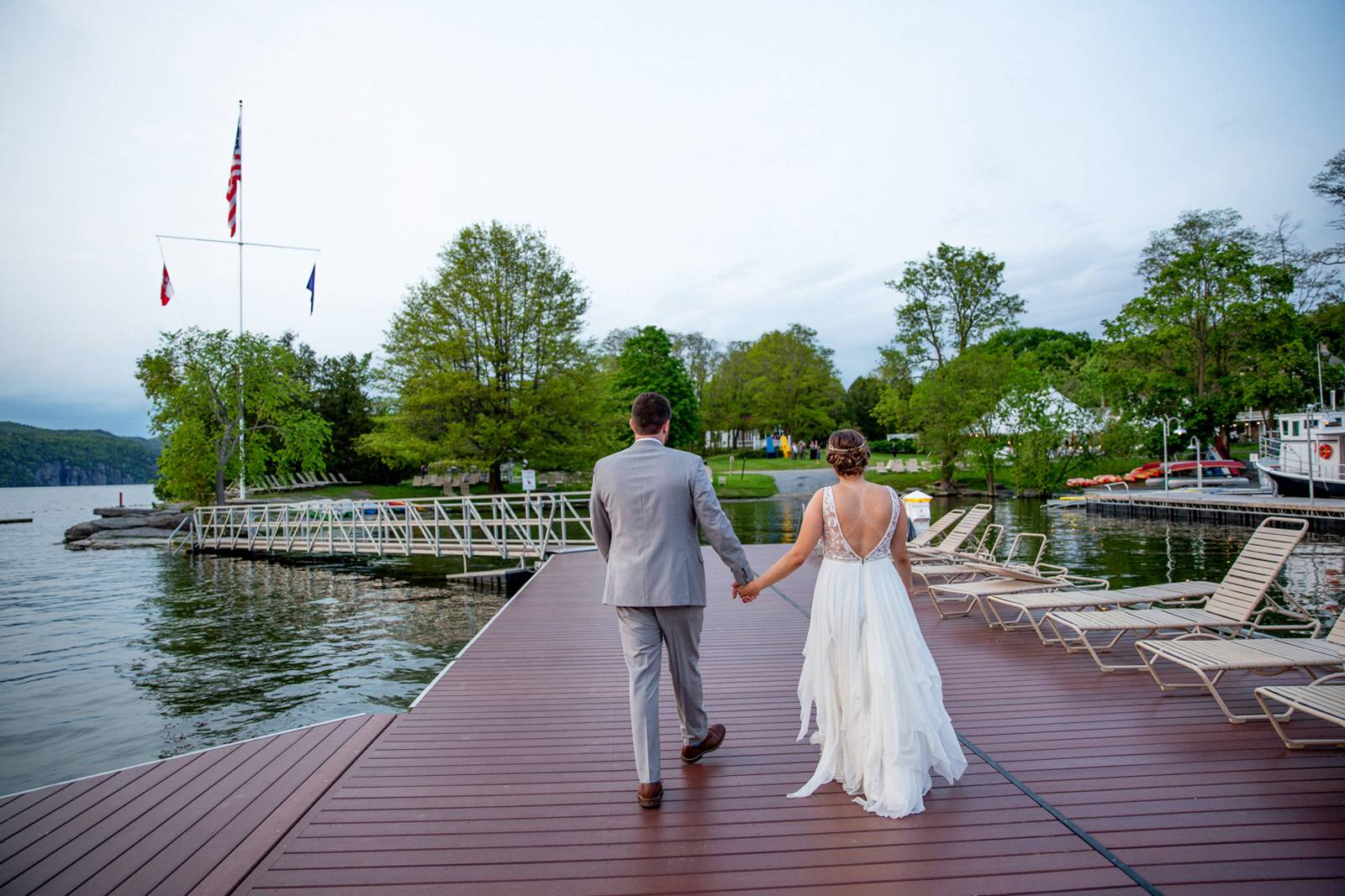 Portrait of bride and groom on dock at Basin Harbor Club during summer wedding