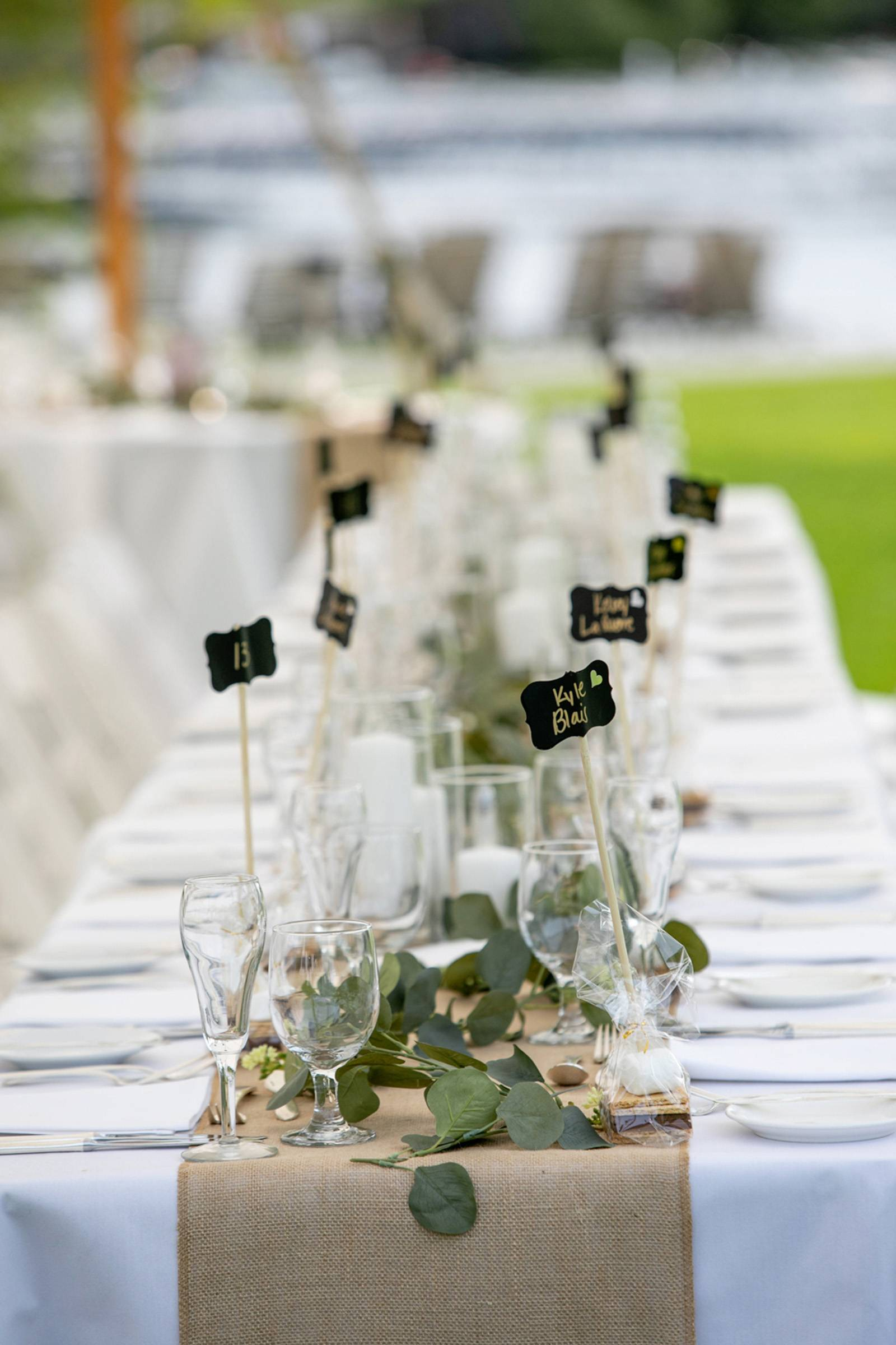 Burlap table runner and eucalyptus greenery on long tables