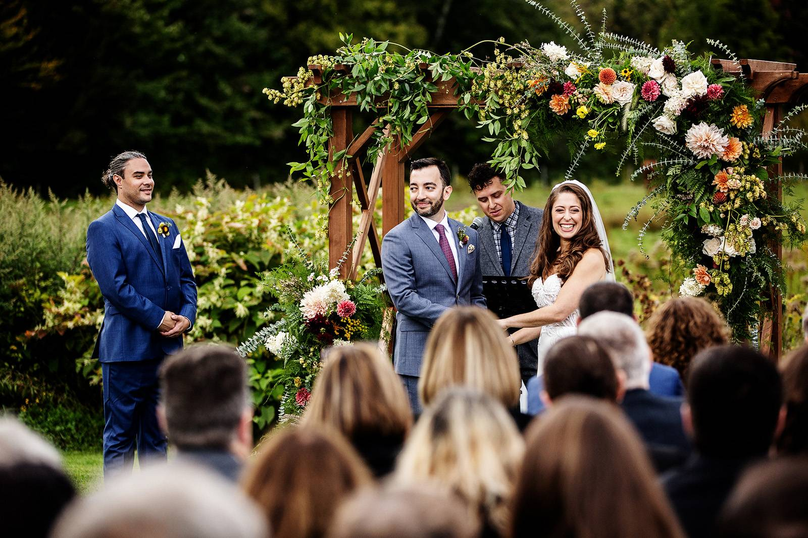 Lush floral ceremony archway decor at fall wedding at Topnotch Resort in Stowe Vermont