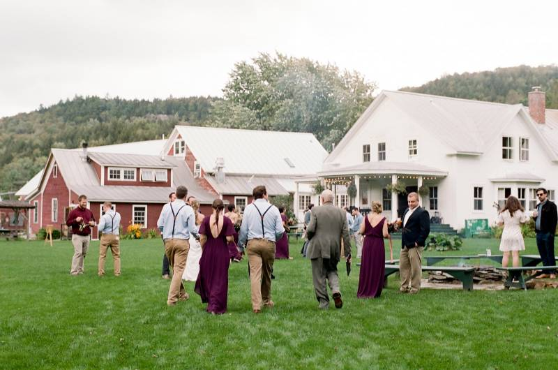 Guests milling around Laurea Farm Inn for outdoor wedding