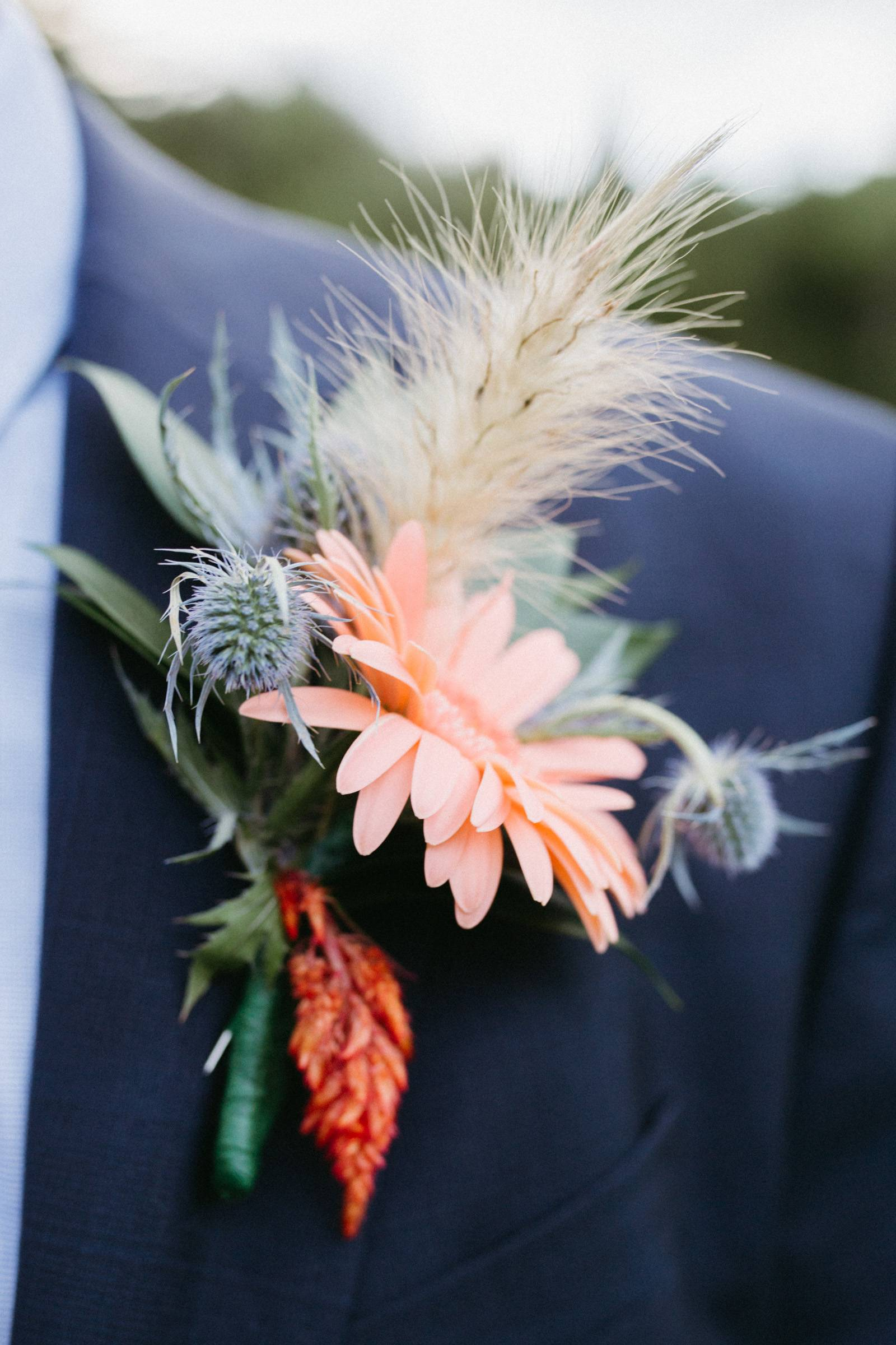 Organic boutonniere with peach flower