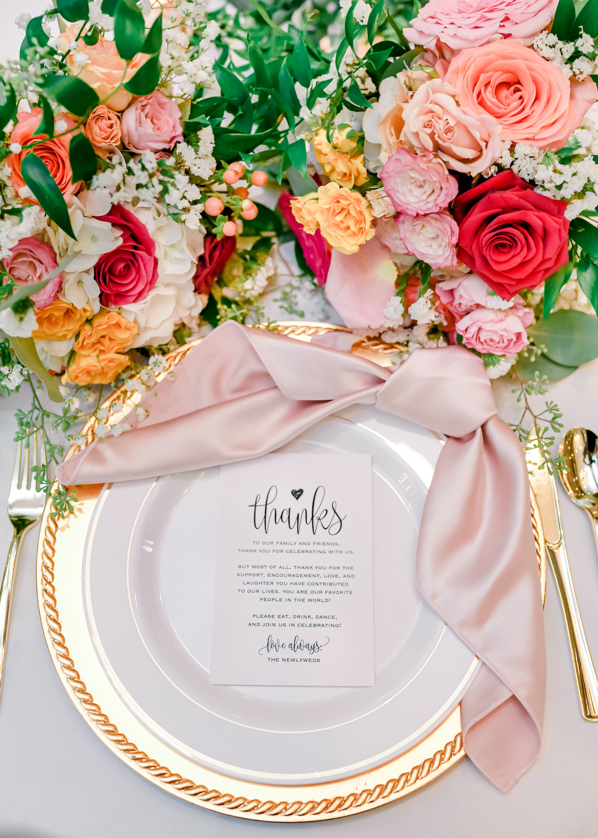 Tablescape details with stationery and floral