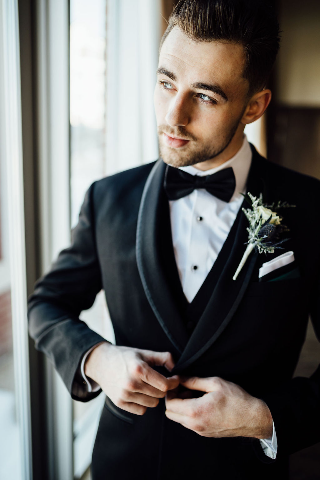 Groom wearing formal tuxedo