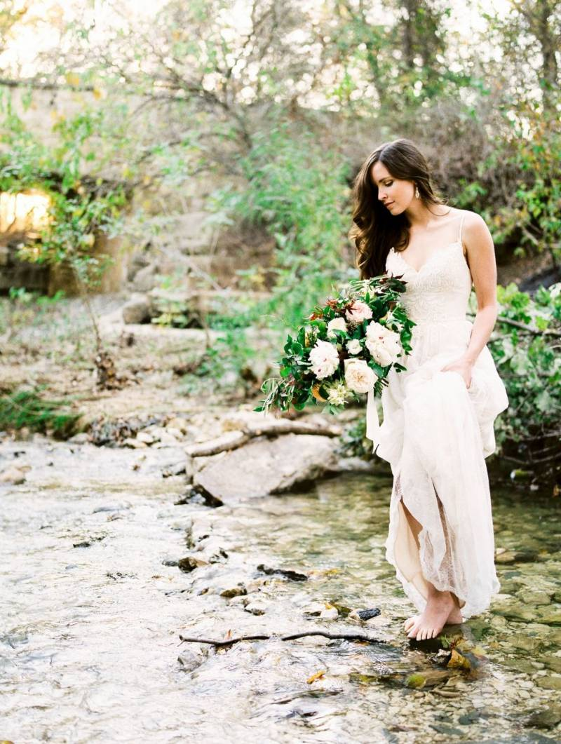 Bride with bouquet in the creek