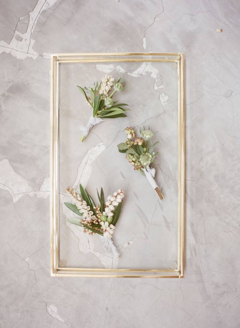 Buttonholes in gold frame