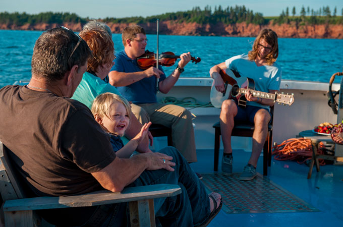 People playing music on a boat