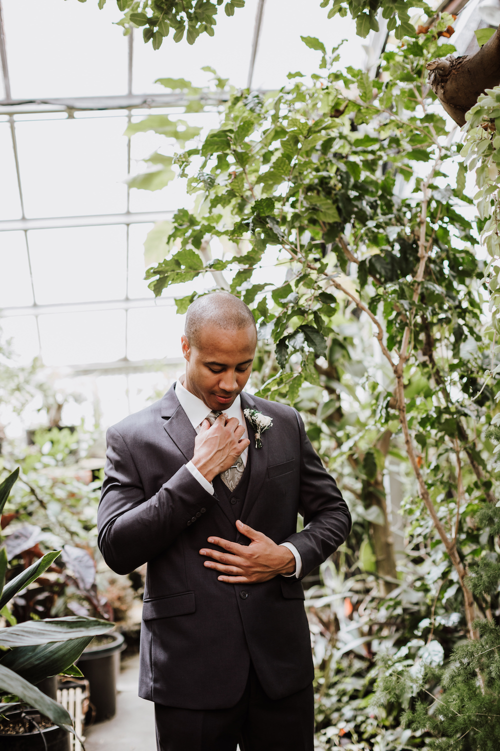 Groom Greenhouse First Look | Central Washington University Wedding With The Sweetest Backstory on A