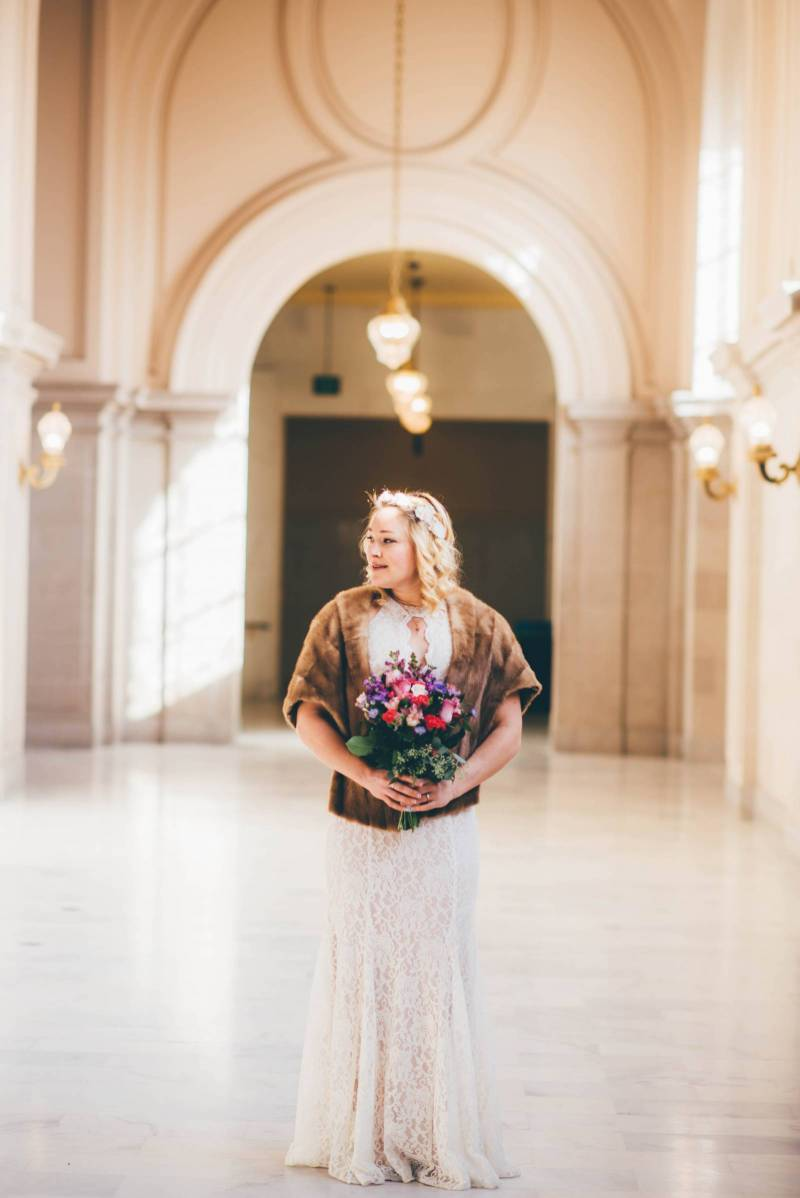 The girl Standing in hall with a Flower Bouquet | The Wedding Standard