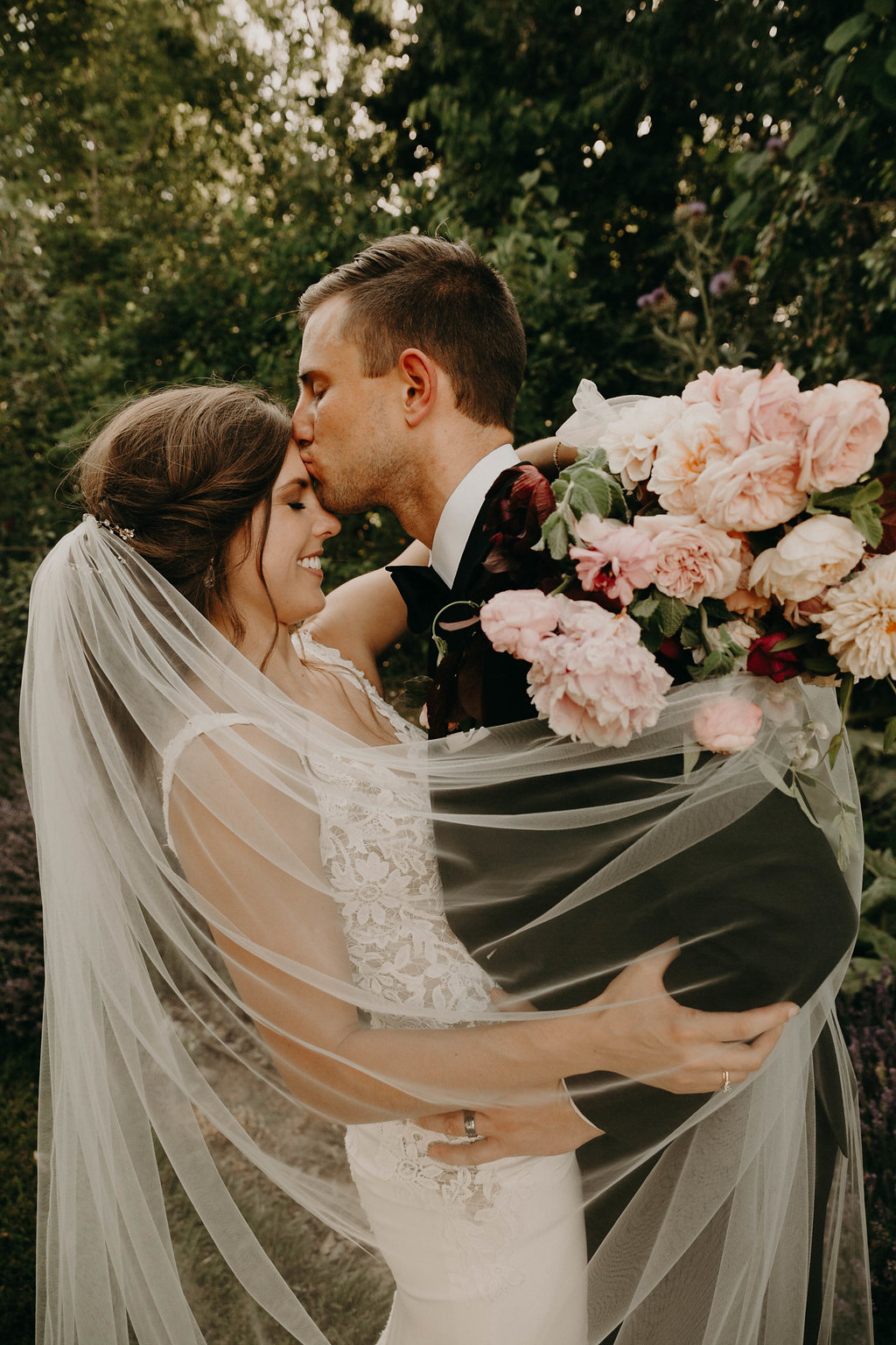 Groom Kissing her Bride on Forehead