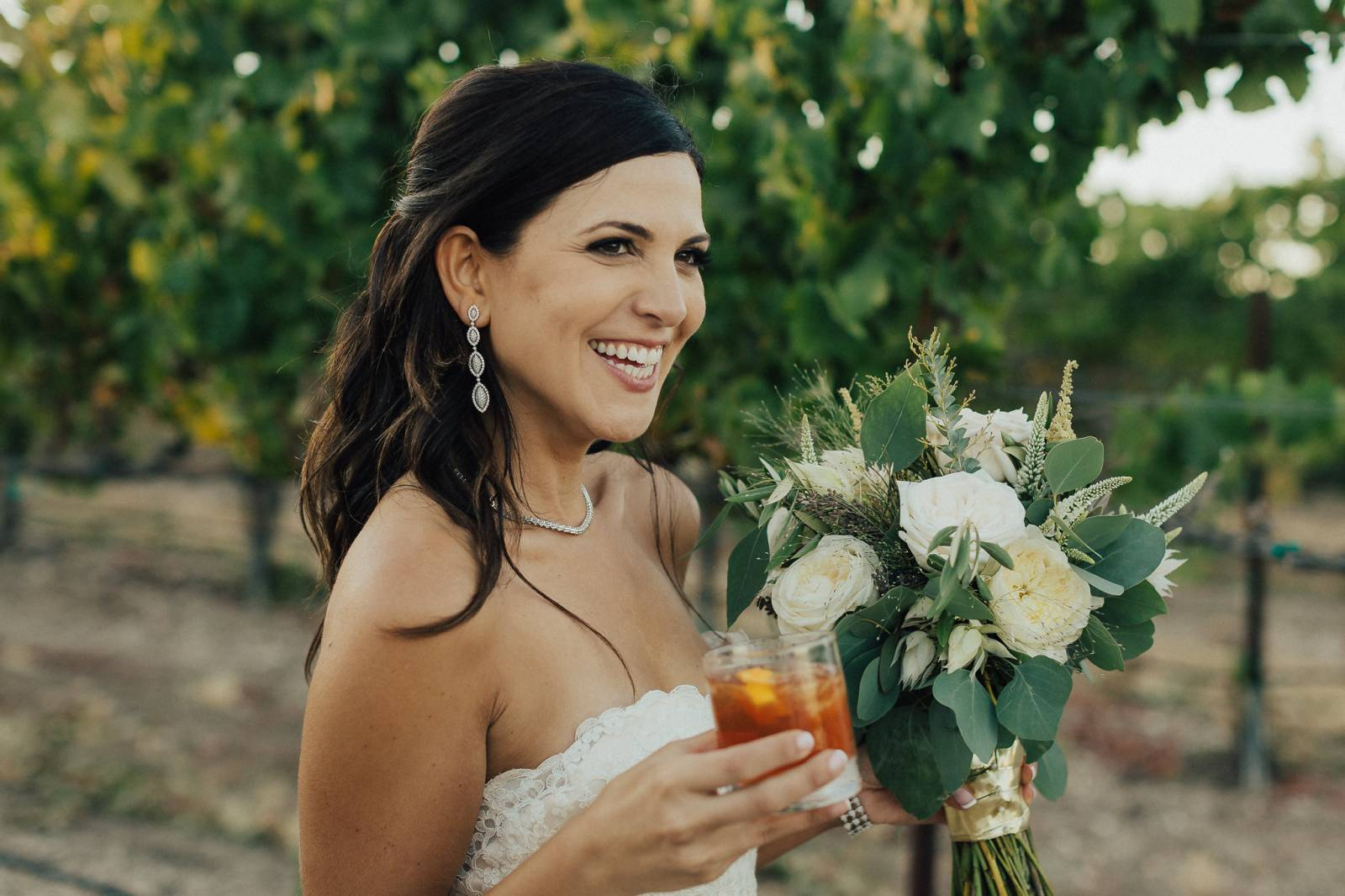 Bride Holding Wine Glass at Edna Valley Winneries | The Wedding Standard