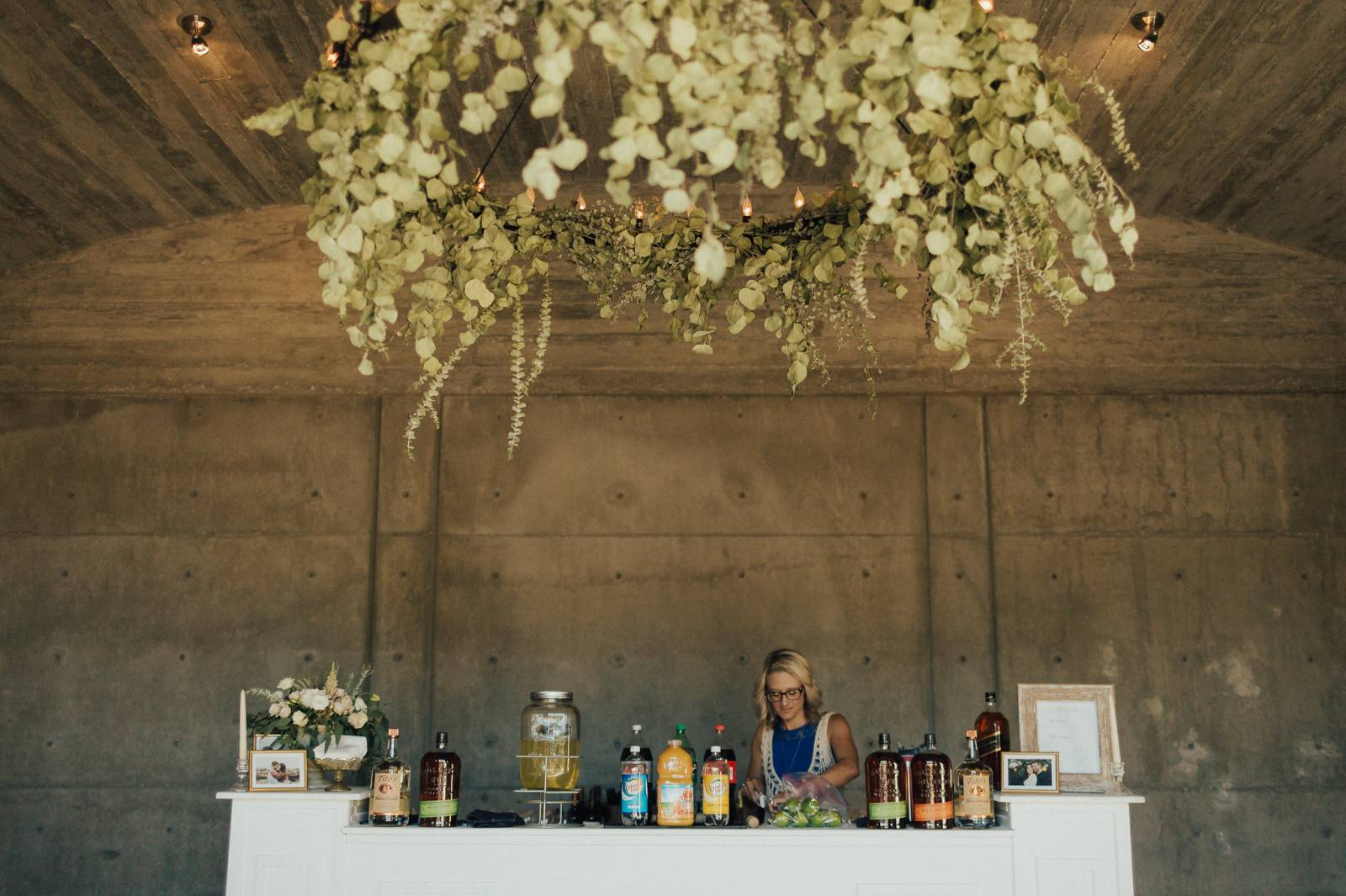 The Girl Preparing the Drinks For the Guests in the Wedding | The Wedding Standard