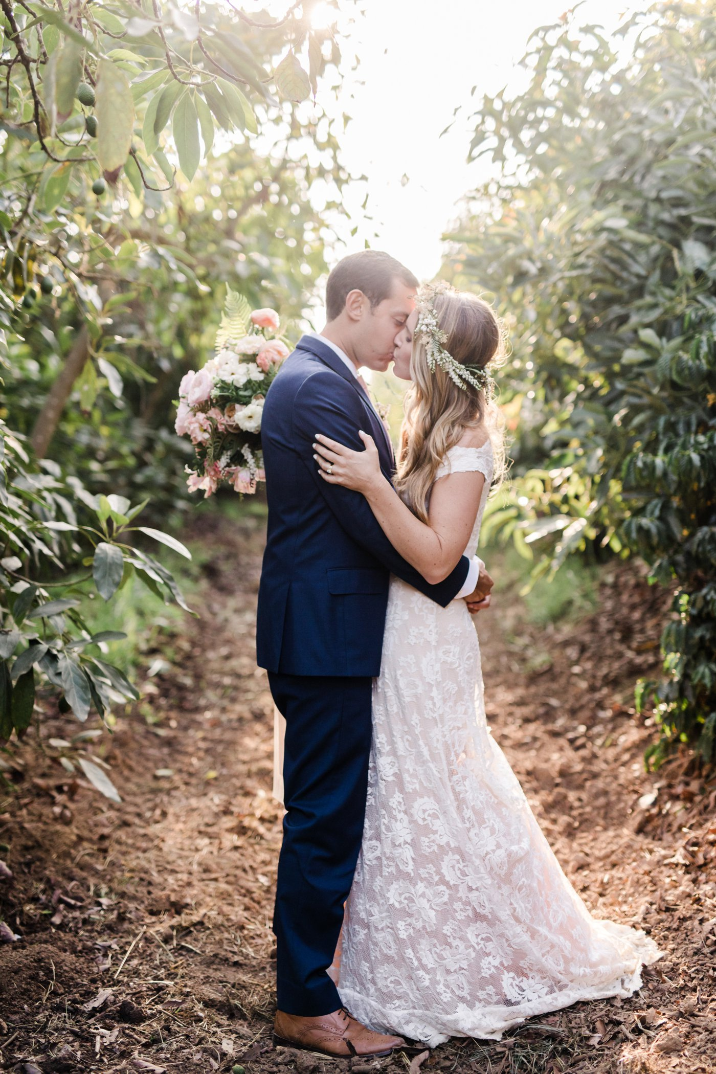 The Newly Married Couple Kissing in the Woods | The Wedding Standard