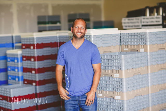 Steven showing Glassware Organized in Crates of Color Coded Cubicles - Cameron Ingalls | The Wedding