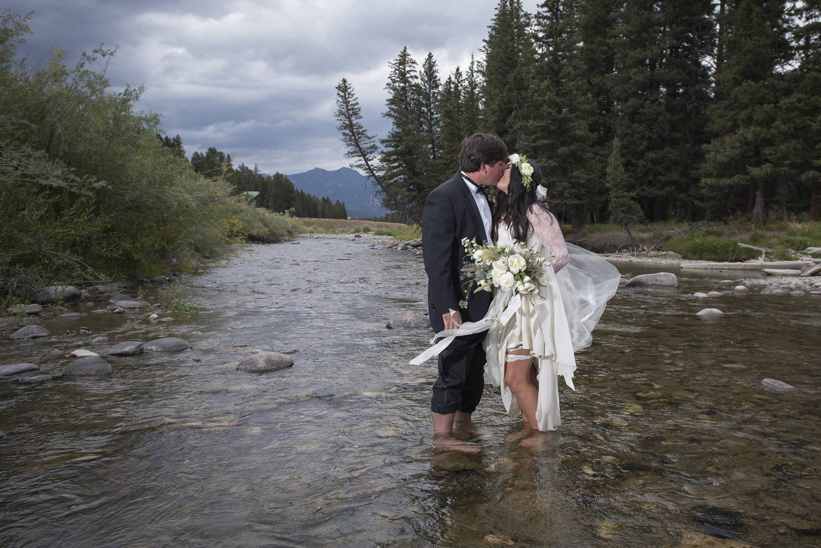 portrait of bride and groom in the river captured by Montana wedding photographers Larry Stanley Pho