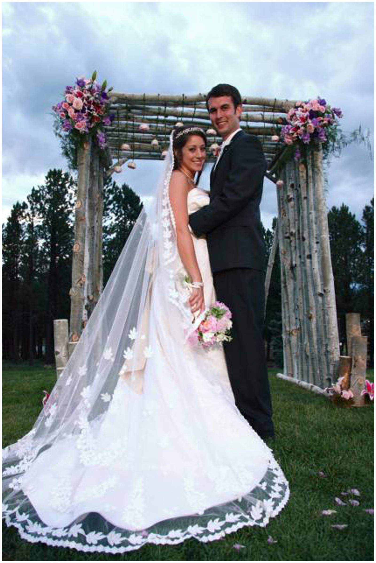 Bride and groom at wedding ceremony alter at Angel Fire Resort