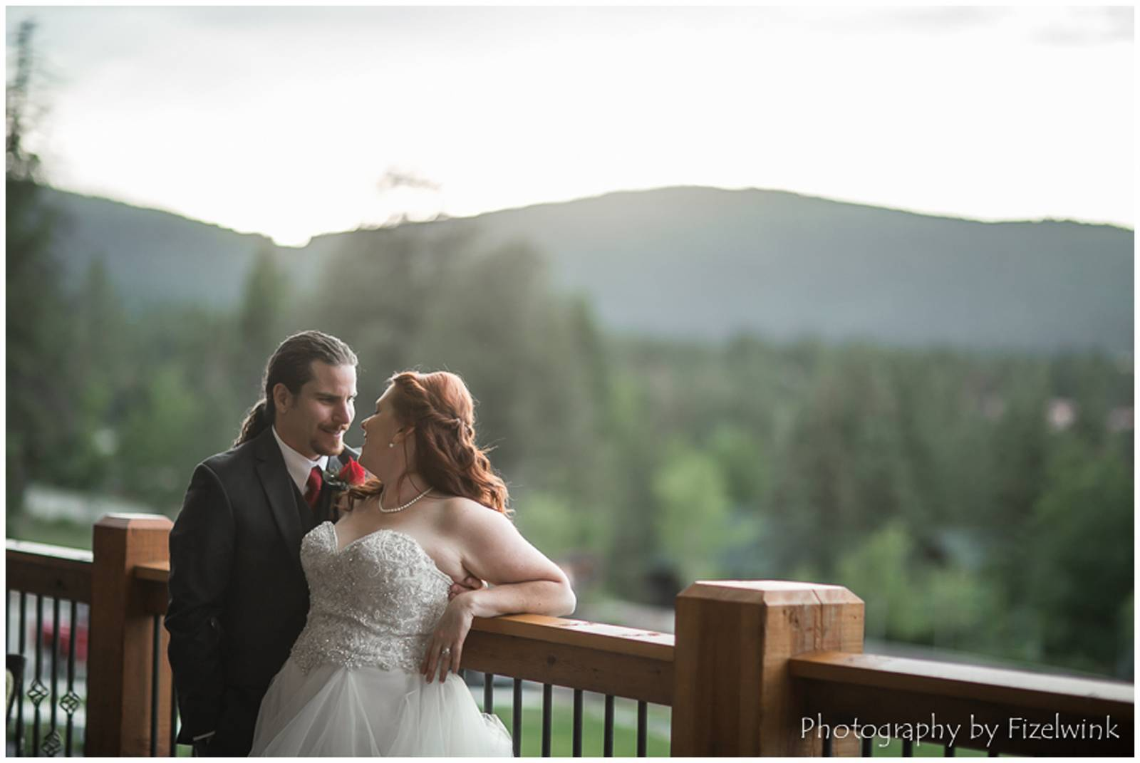 bride and groom at Angel Fire Resort with mountain wedding view