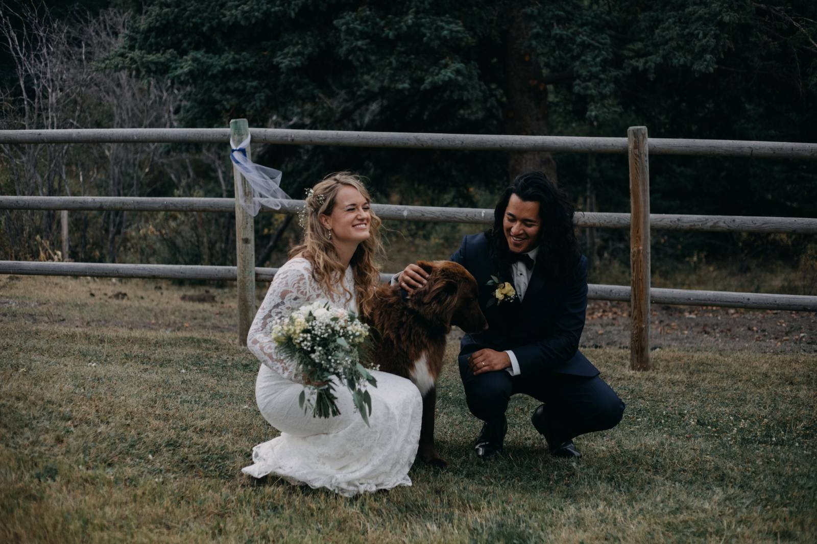 rustic bohemian wedding photo with dog captured by Alberta wedding photographer Malorie Reiter