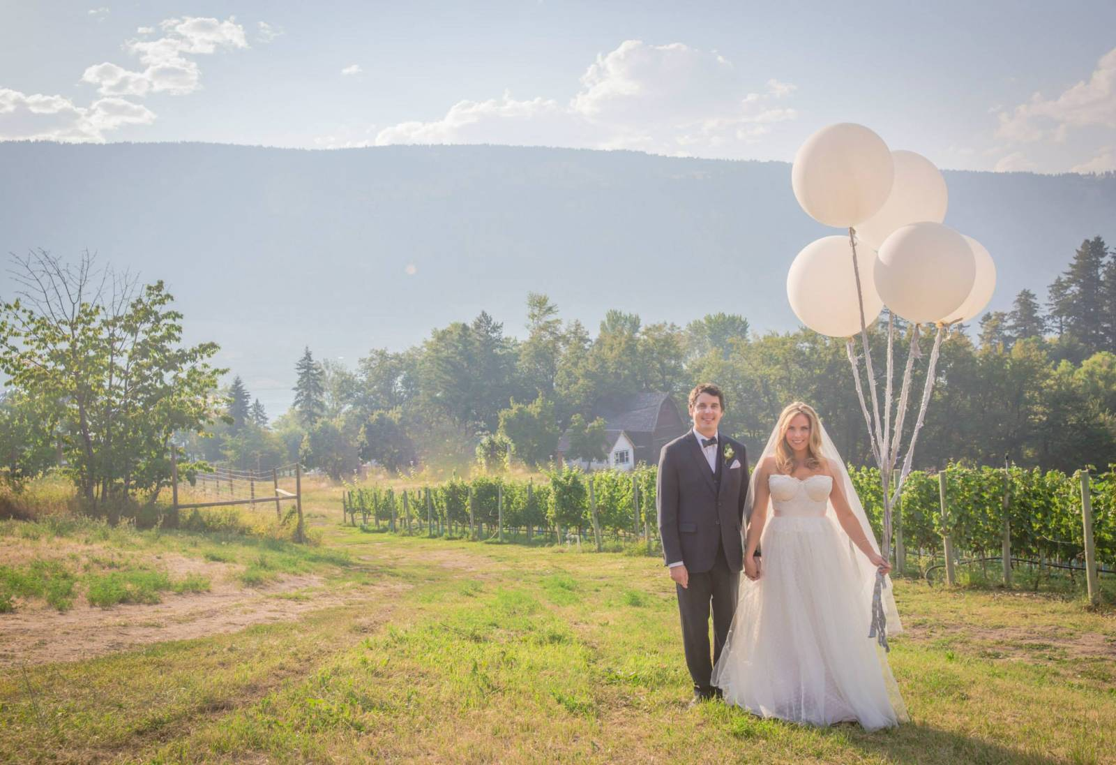 mountain wedding portrait inspiration | bride holding large white balloons planned by Emma McCormick