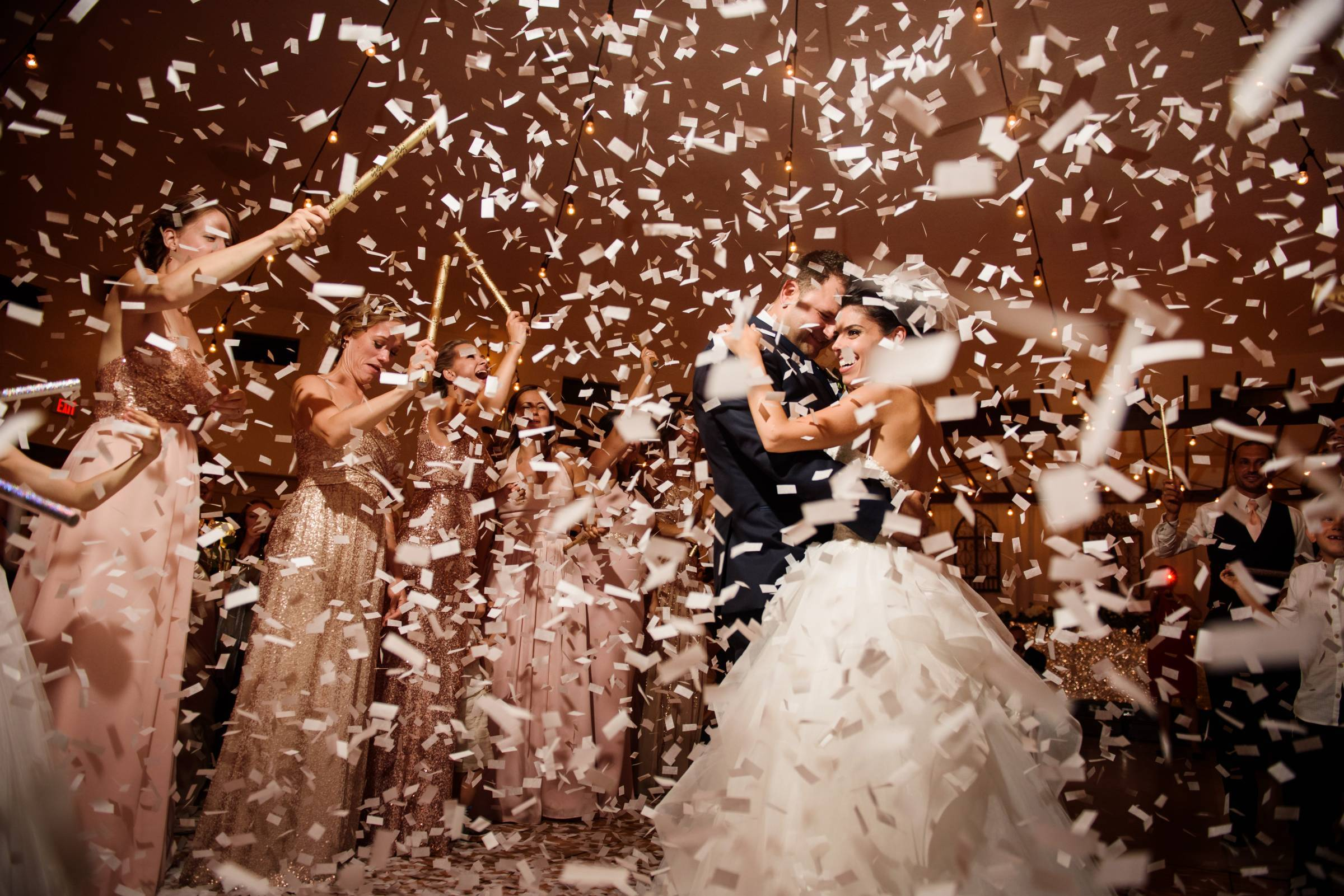 bride and groom dancing under confetti | Emma McCormick - Creative Planning + Production