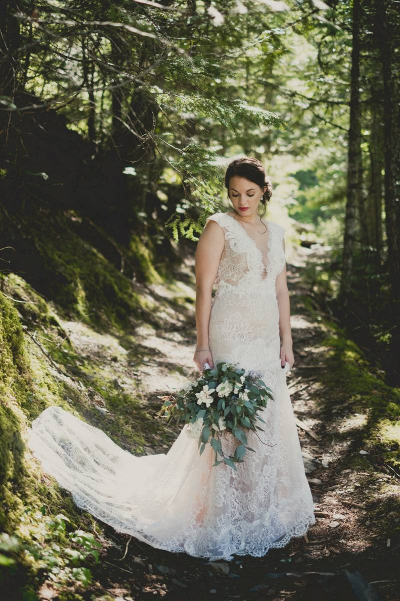 lace wedding gown on bride to be | wedding photo captured by Montana wedding photographer Jennifer M