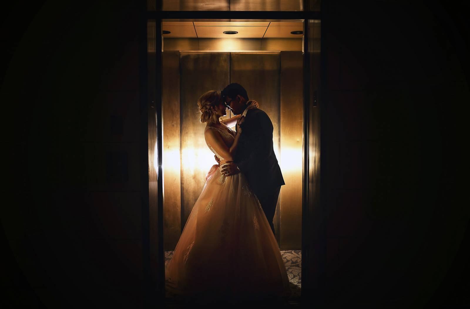 artistic shot of bride and groom in the hotel elevator captured by Cat Lemus Photography & Cinema
