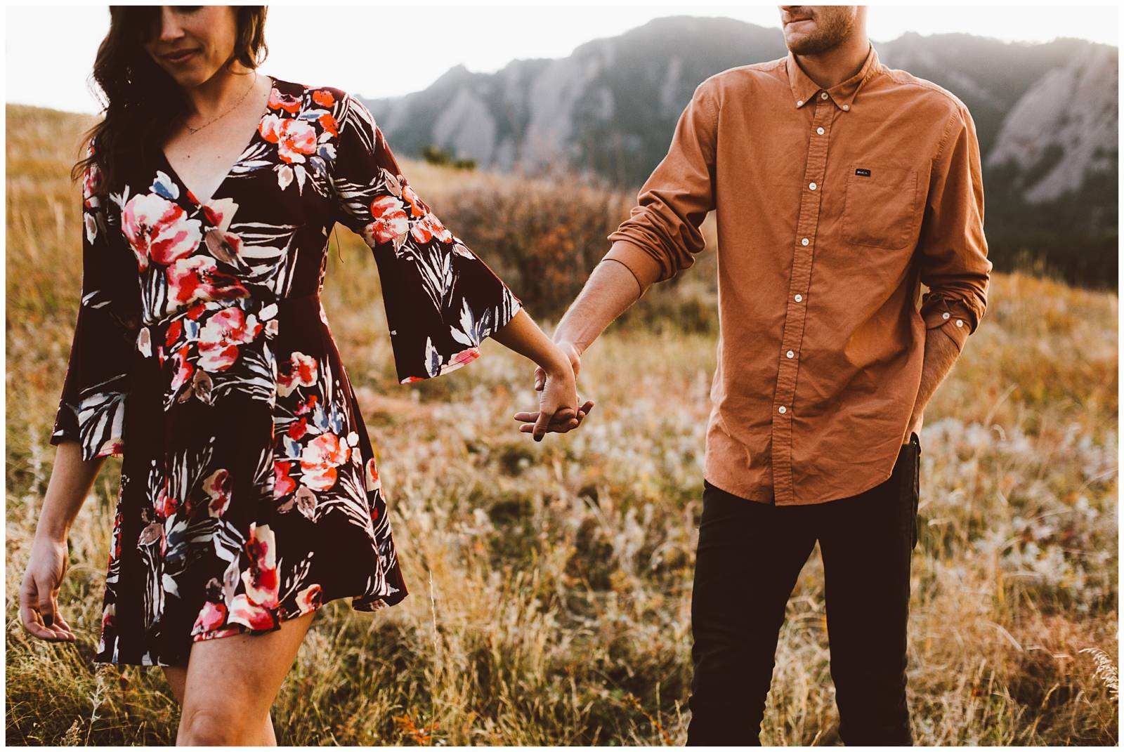 young couple holding hands | moody engagement photo inspiration