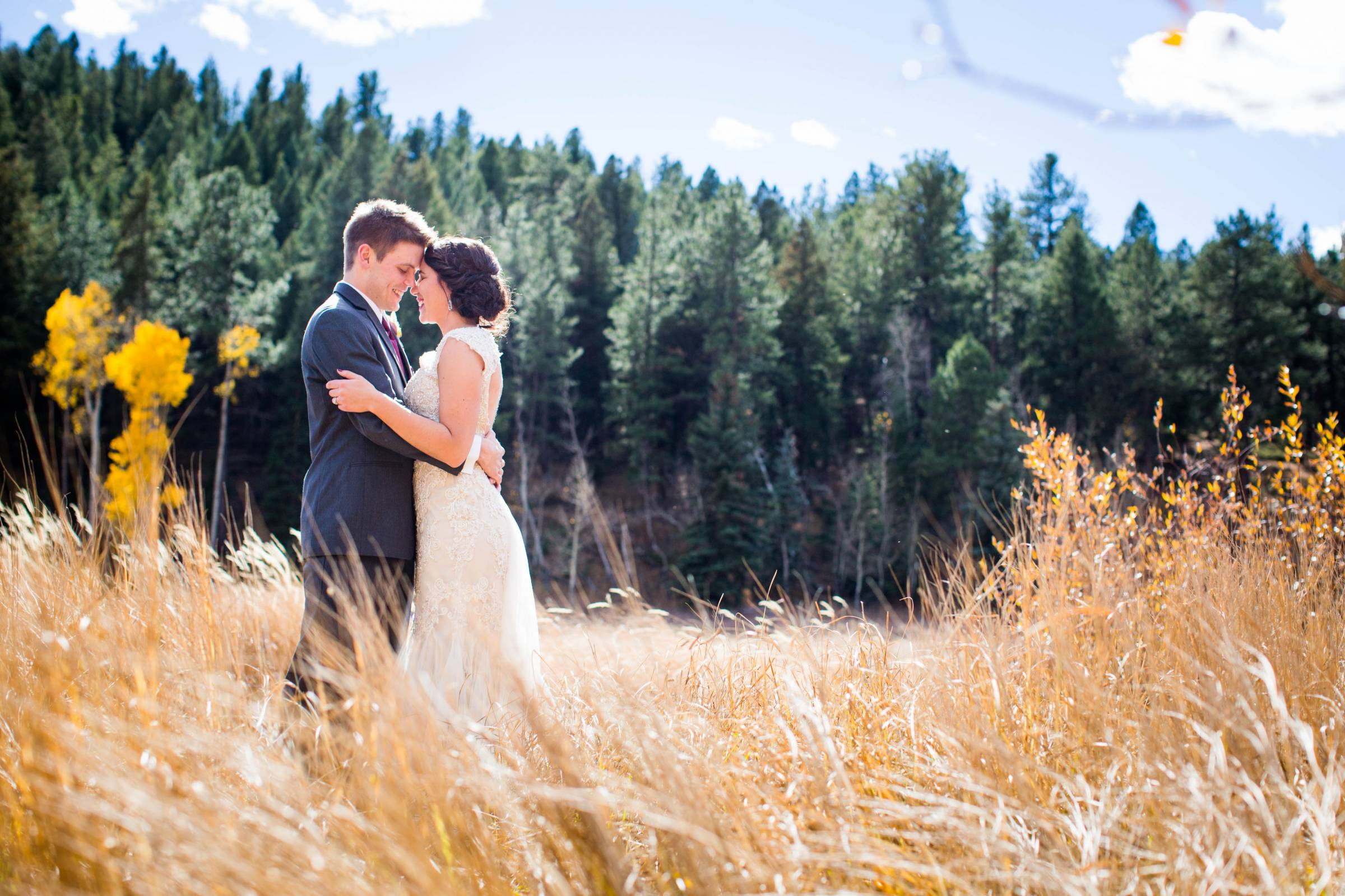 Bride and groom portrait at their Rocky Mountain wedding planned by Glow Events