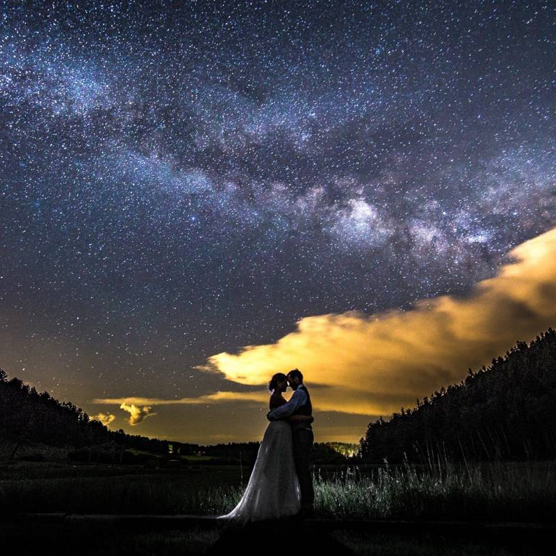 Rocky Mountain night sky wedding portrait of bride and groom