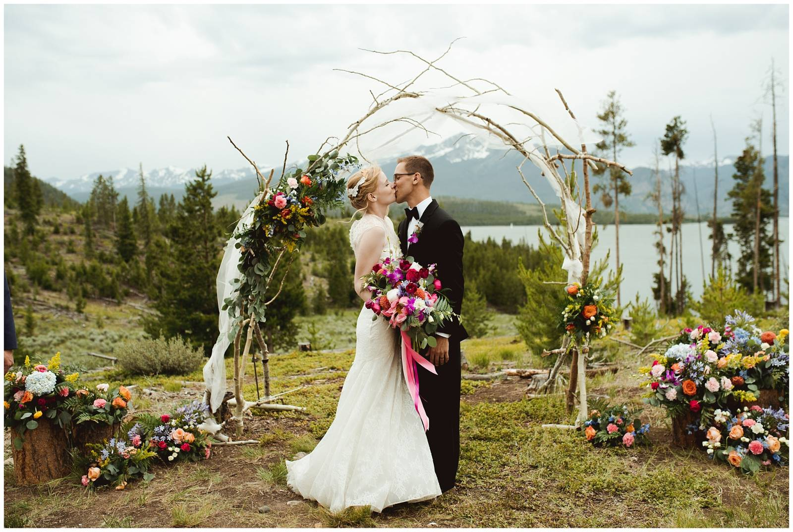 intimate Rocky Mountain bride and groom kissing at wedding planned by Glow Events
