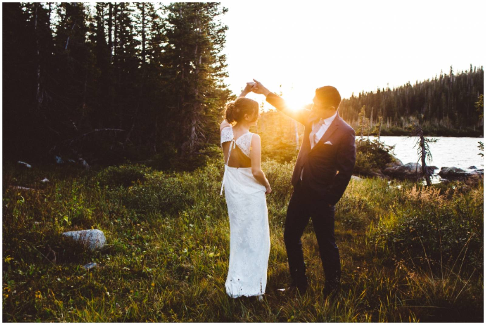 Shayla Velazquez Photography captures groom twirling bride at sunset wedding in the Rocky Mountains
