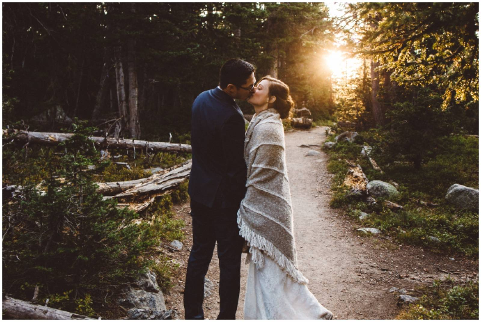 bride and groom kissing at a sunset destination Rocky Mountain wedding | Shayla Velazquez Photograph