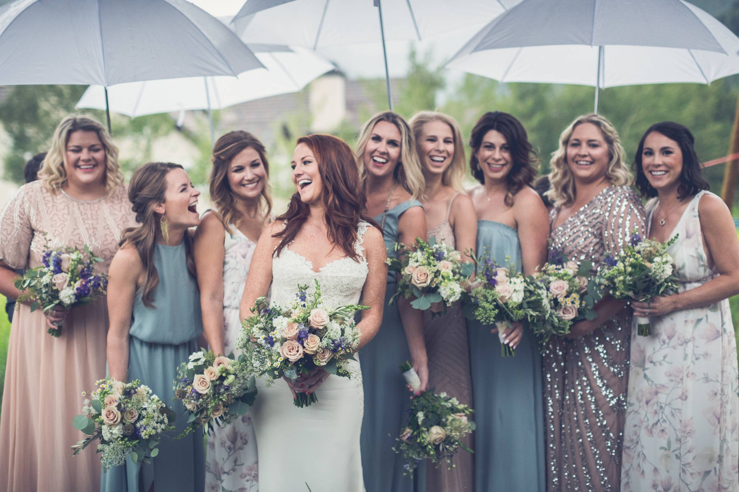 Colorado wedding planned by Revel & Roots Events | bride with bridesmaids in mismatched dresses