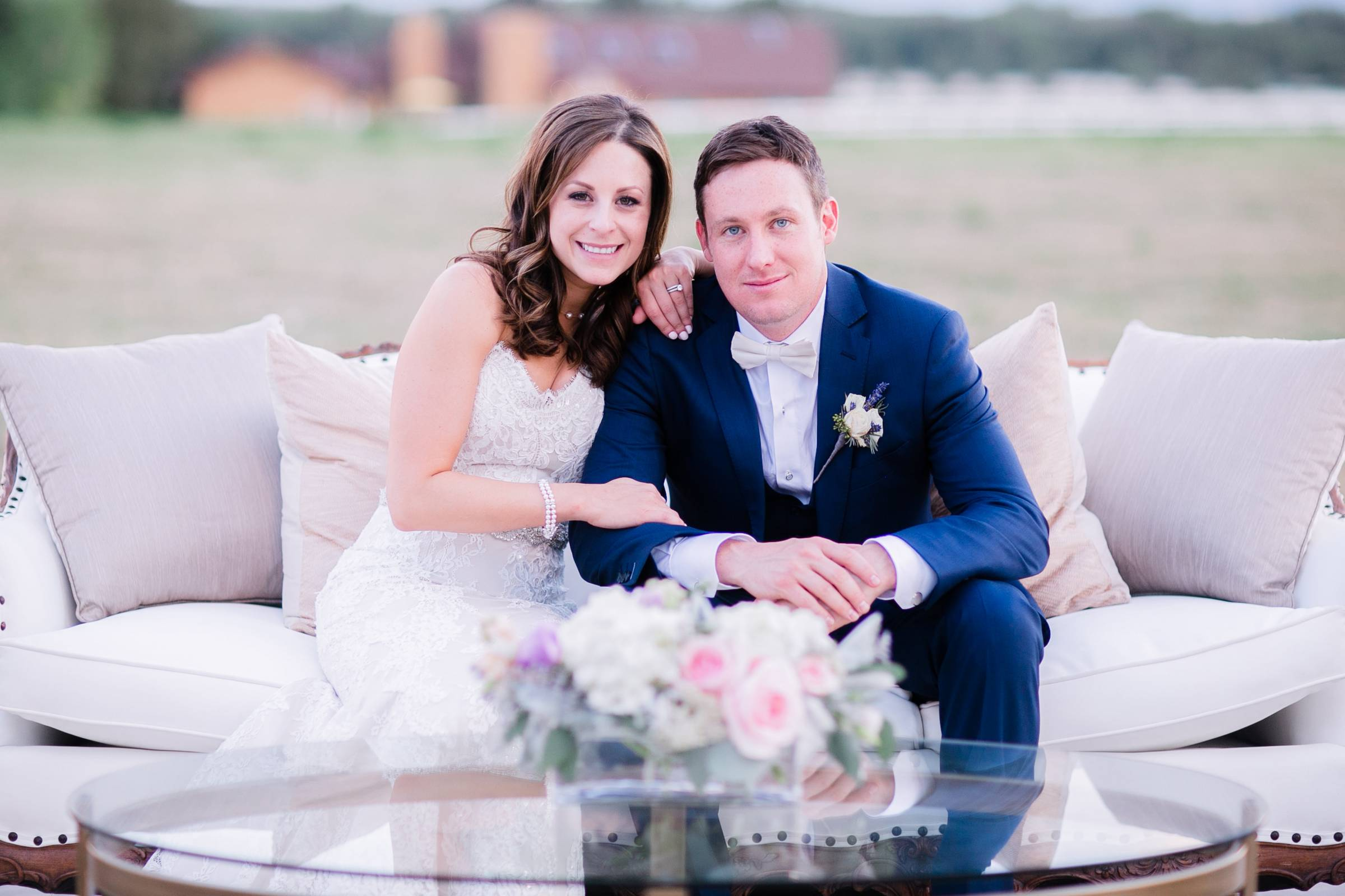 Colorado wedding planned by Revel & Roots Events | bride and  groom sitting on couach