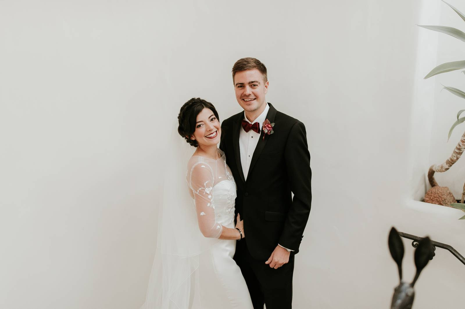 bride and groom smile for picture | bride wearing an Enzoani wedding gown