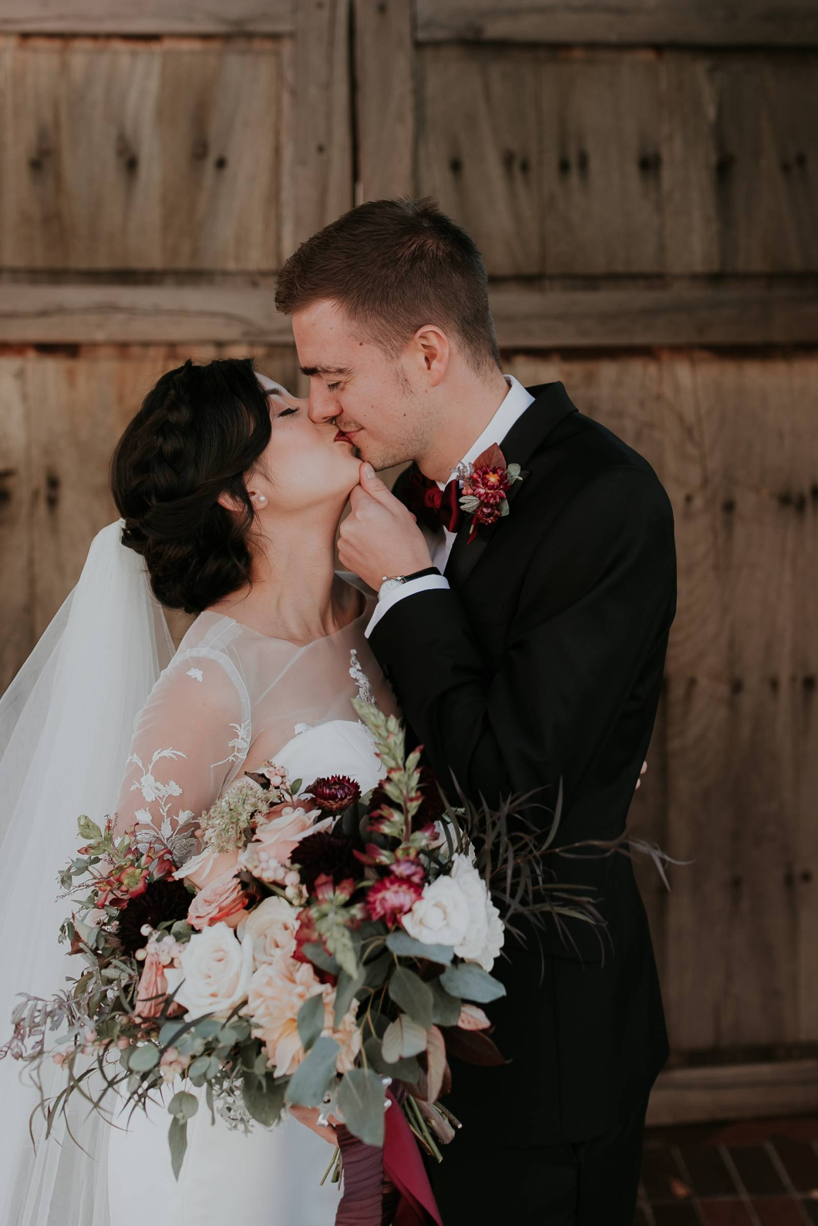 bride and groom kissing outside at Sante Fe wedding