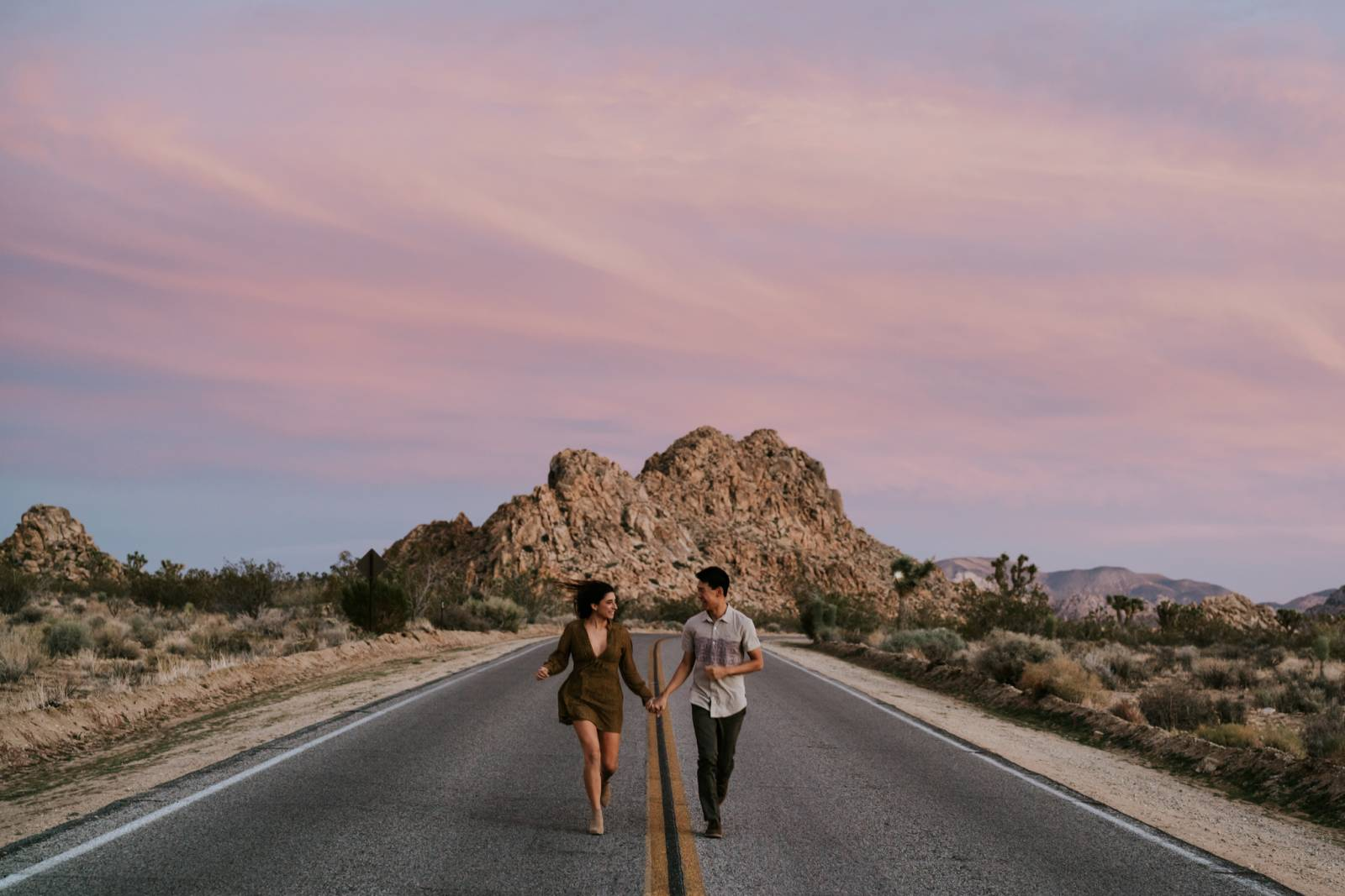 outdoor adventure sunset engagement photo of young couple captured by Thistle & Pine Creative