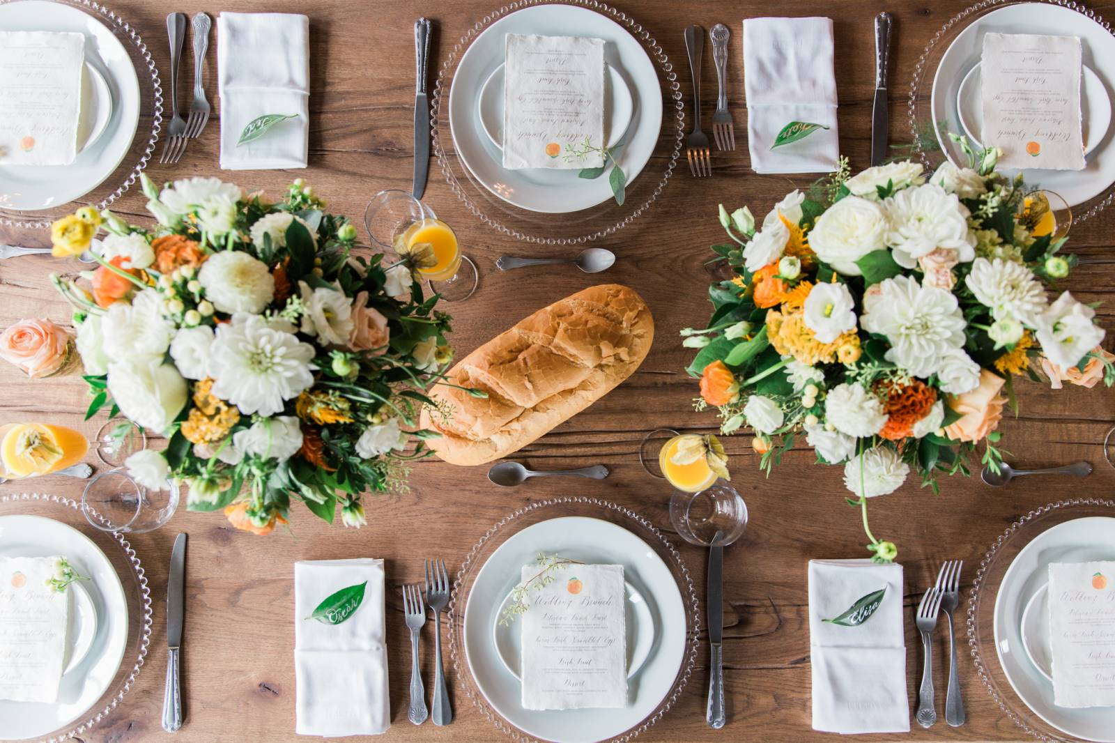 brunch wedding reception inspiration | mimosas and orange and yellow wedding flower centerpiece