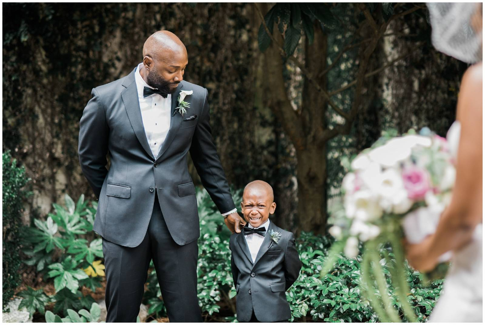 classic wedding photo of groom and son captured by Ali & Garrett Photographers