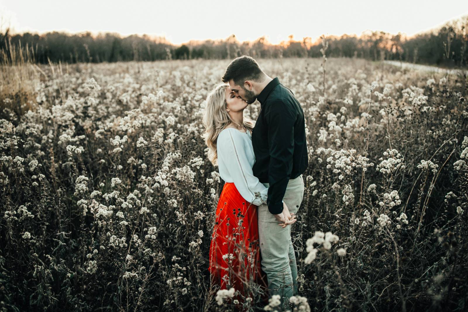 Jaclyn Dickens Photography | engagement photo in a field of flowers