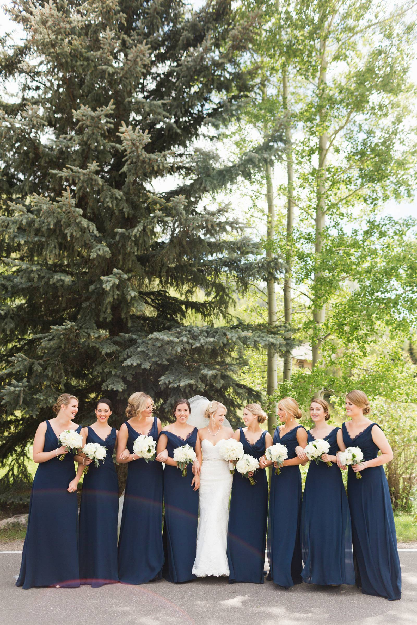 bridesmaids in navy dresses | classy Rocky Mountain wedding in Vail, Colorado
