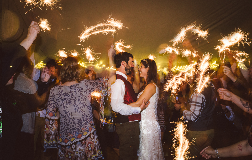 Bride and Groom with sparklers designed by Wild Rose | Jackson Hole Wedding
