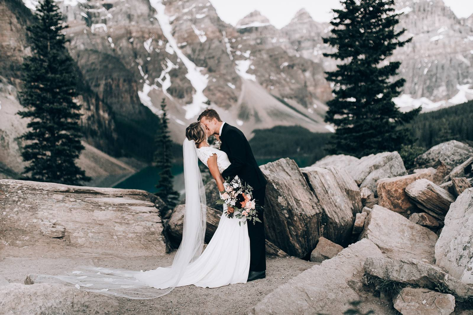 stunning mountain portrait of bride and groom | Lake Louise, Alberta wedding inspiration