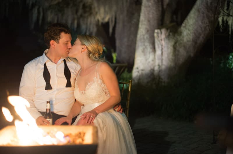 bride and groom at fire pit
