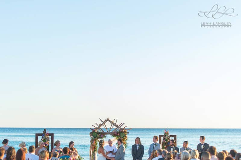 couple getting married on the beach in their wedding ceremony
